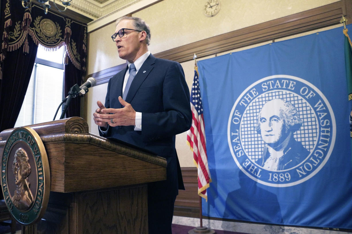 Washington Gov. Jay Inslee talks to the media about the status of ongoing state budget negotiations, Friday, June 19, 2015, in Olympia, Wash. Inslee says new taxes are off the table, and he encouraged the House and Senate to consider closing some tax exemptions as a compromise.