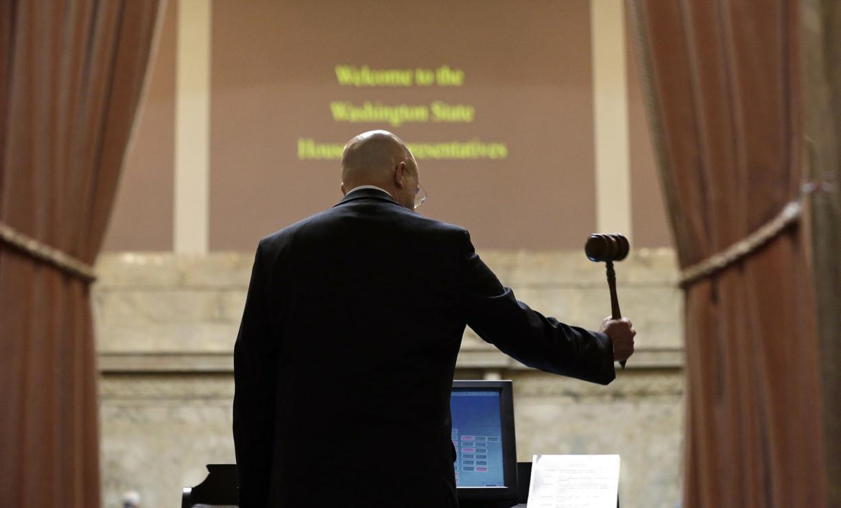 House Speaker Pro Tempore Jim Moeller pounds a gavel in the House Chamber to begin the first day of a 30-day special session of the Legislature Wednesday, April 29, 2015, in Olympia, Wash.