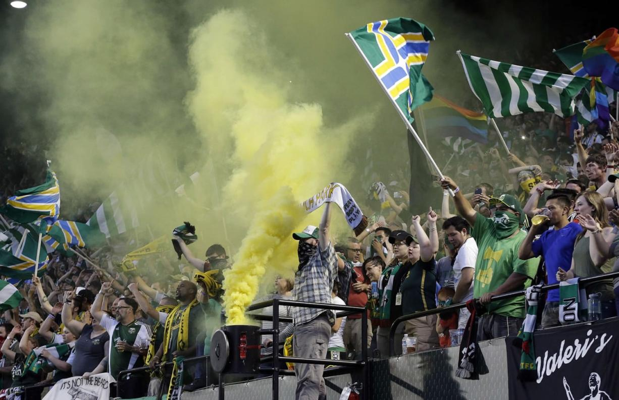 Portland Timbers fans celebrate after a goal during the second half of an MLS soccer game against the Houston Dynamo.