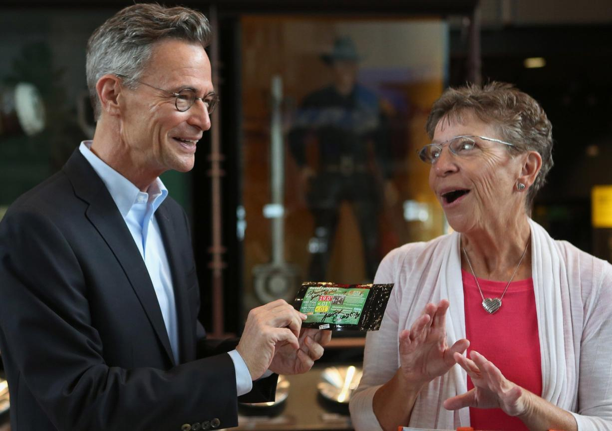Leonard Garfield, executive director of Seattle's Museum of History and Industry, holds two grams of pot, part of Seattle's first legal pot purchase that Greene donated to the museum Tuesday.