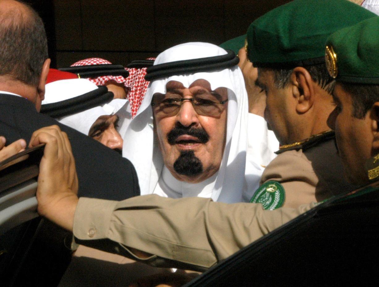 In this Tuesday, Aug. 2, 2005 file photo, Saudi Arabia's new King Abdullah leaves after special prayers for late King Fahd at Riyadh, Saudi Arabia's Turk bin Abdullah mosque.