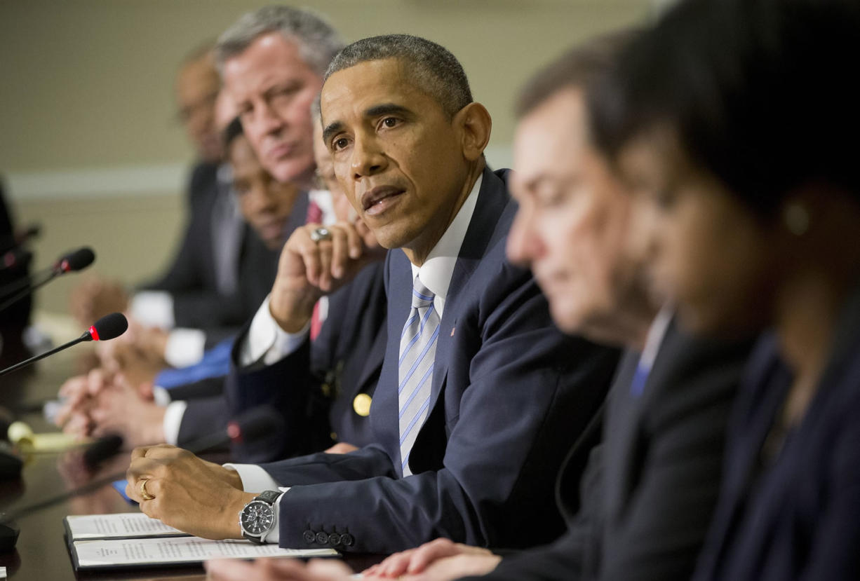 President Barack Obama, center, speaks during his meeting with elected officials, law enforcement officials and community and faith leaders in the Old Executive Office Building on the White House Complex in Washington, Monday, Dec. 1, 2014.