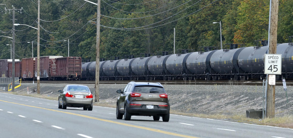 A long line of rail cars containing oil sit on tracks south of Seattle in September.