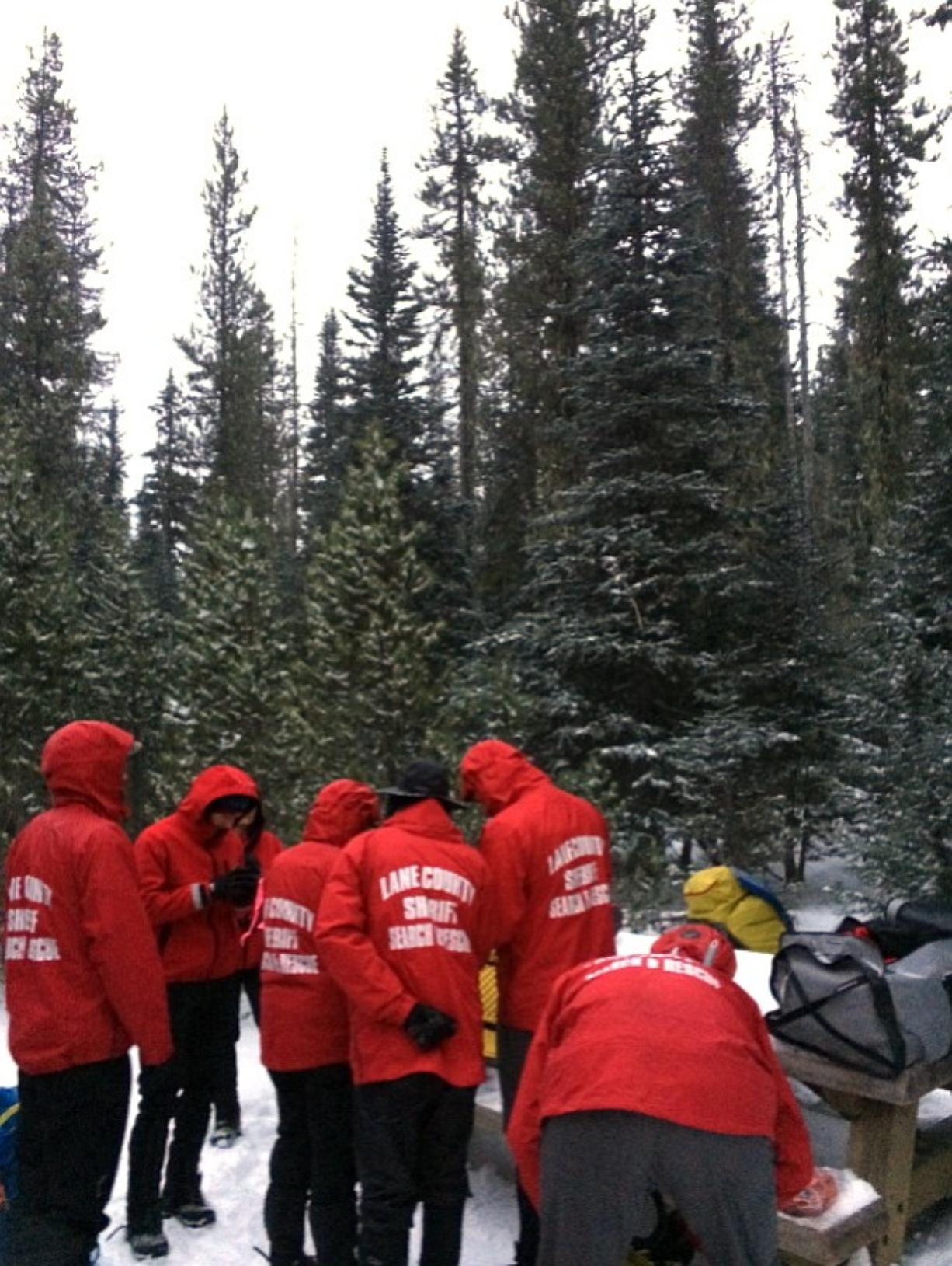 Lane County Sheriff Search and rescue members gather on central Oregon's Middle Sister mountain Friday, near Sisters, Ore., as the search for a missing climber continues.