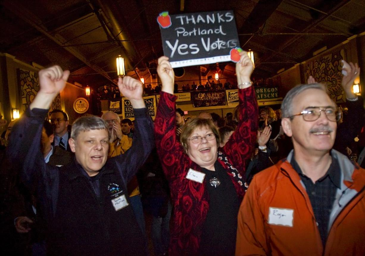 Supporters of Measures 66 and 67 celebrate early returns in Portland on Tuesday night.
