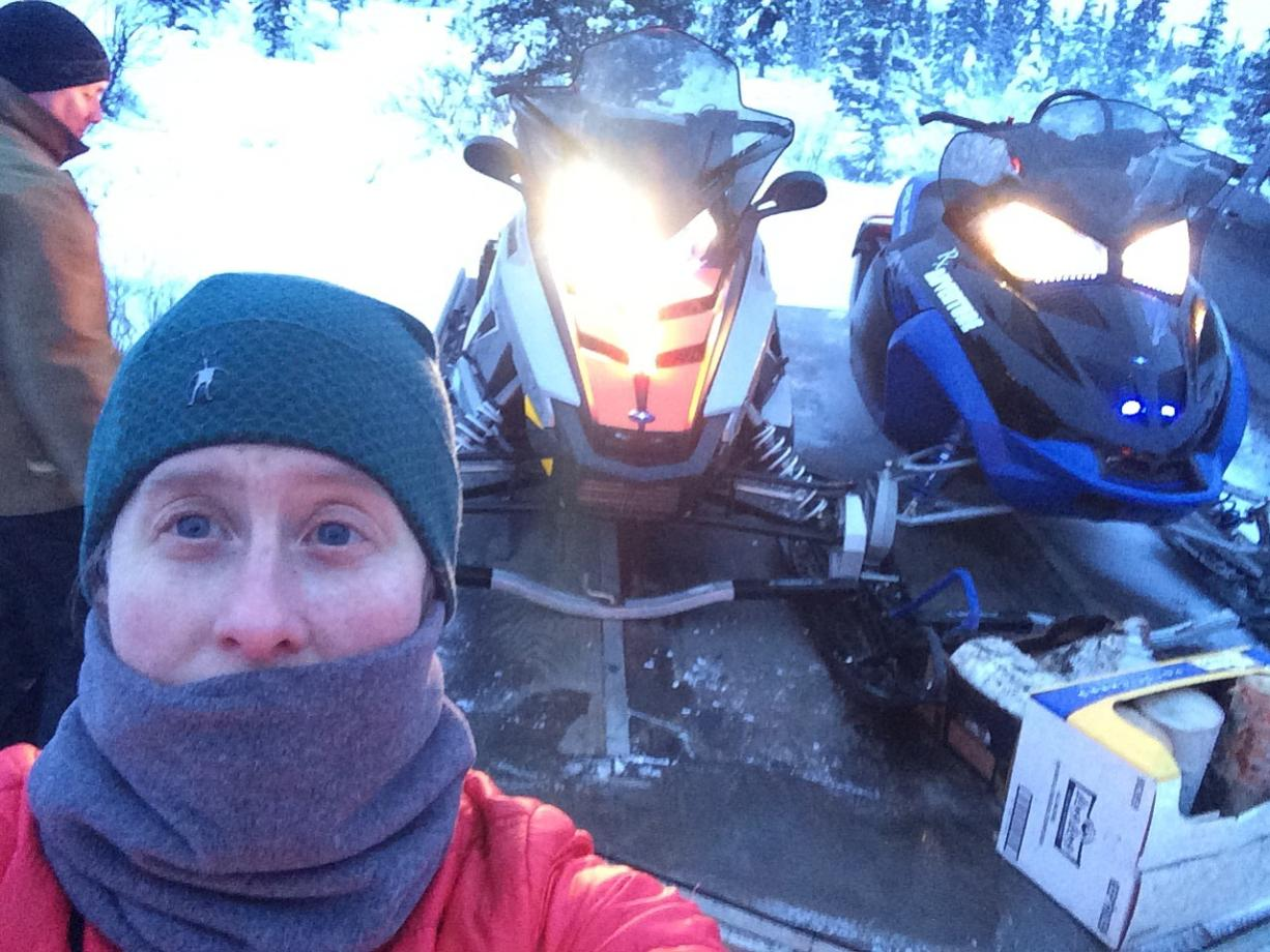 Beth Ipsen takes a selfie showing her clothing and snowmobiles in 2013 before heading out in the wilderness near Cantwell, Alaska.