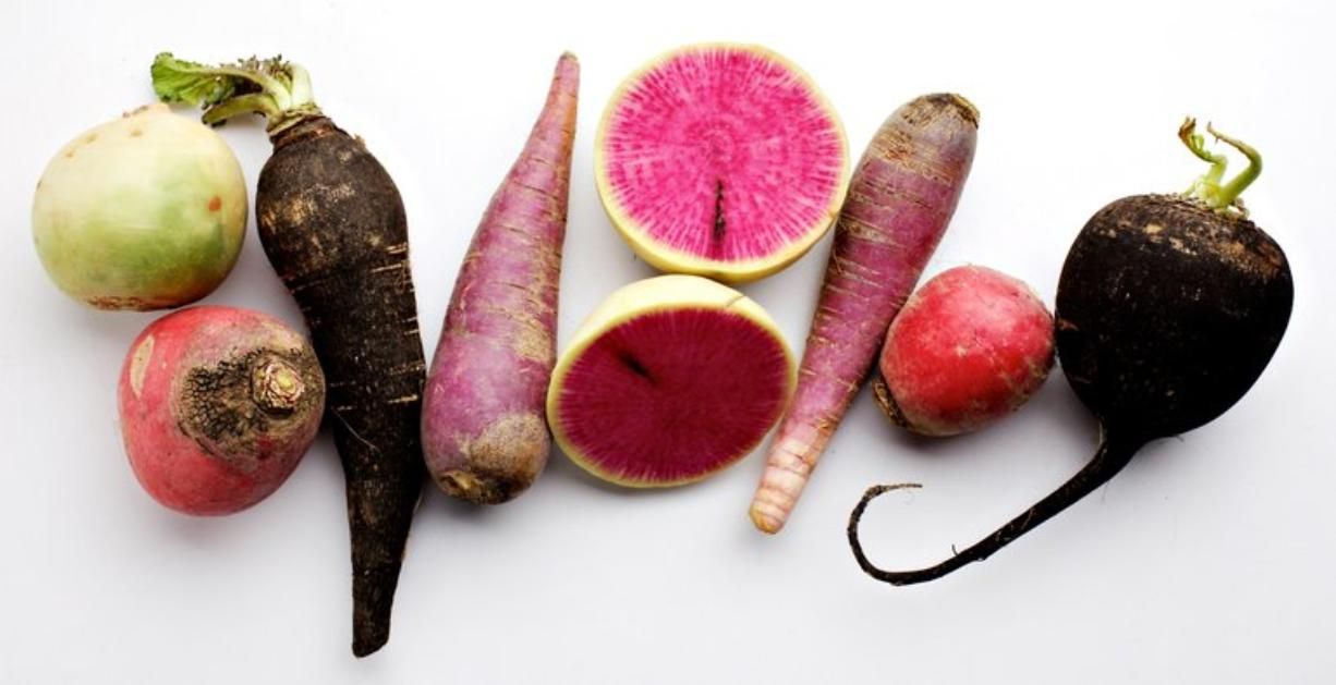 The Washington Post Radishes can add a variety of color and pepperiness to the winter table. From bottom: Misata Rose, China Rose, Spanish Black, Hilds Blauer, a sliced Misata Rose, Hilds Blauer, China Rose and Spanish Black.