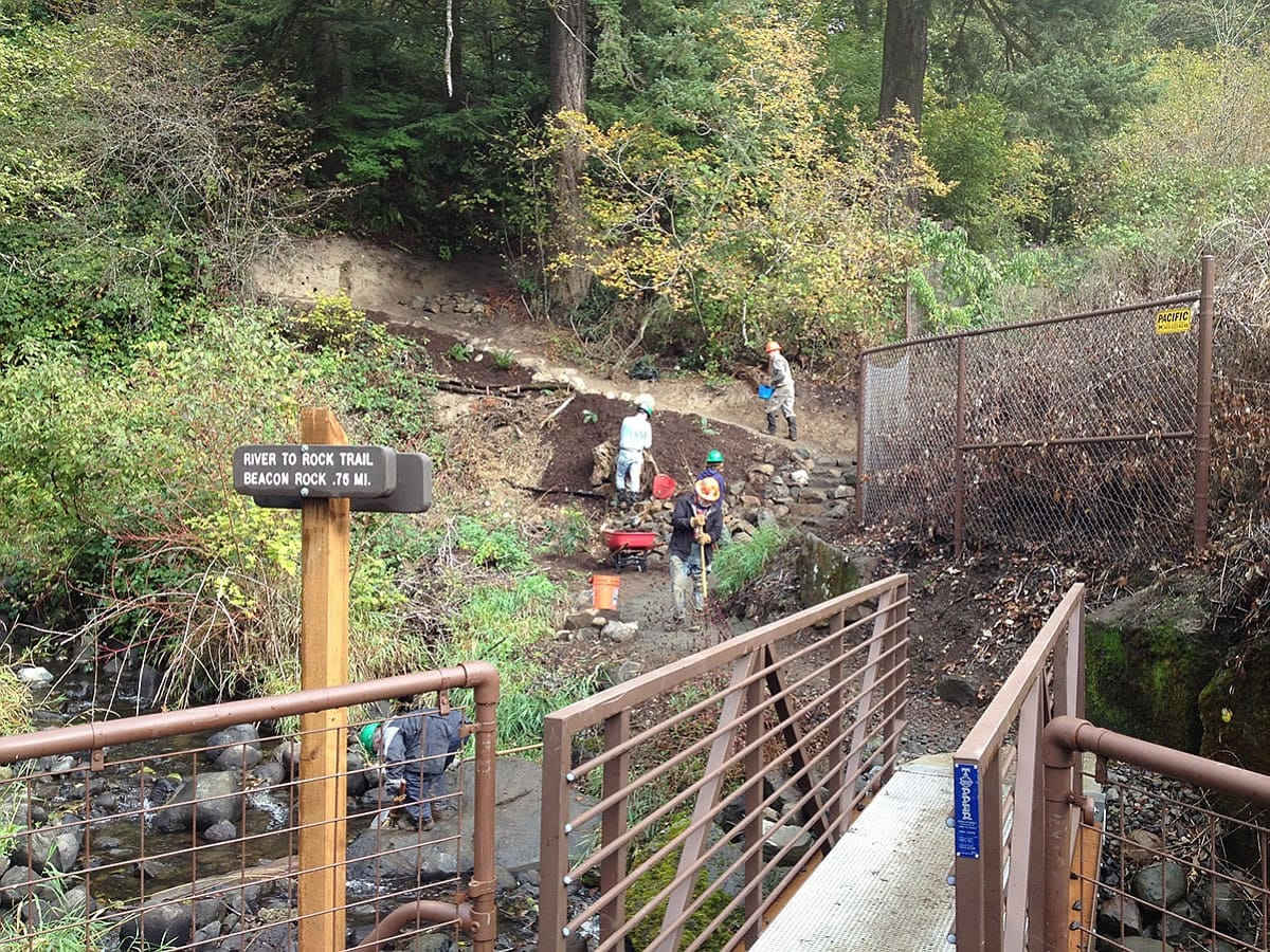 Ryan Ojerio/Washington Trails Association   Washington Trails Association volunteers finish the stone steps up the River to Rock Trail, a new connector path that links the day-use area to the trail to the top of Beacon Rock State Park.