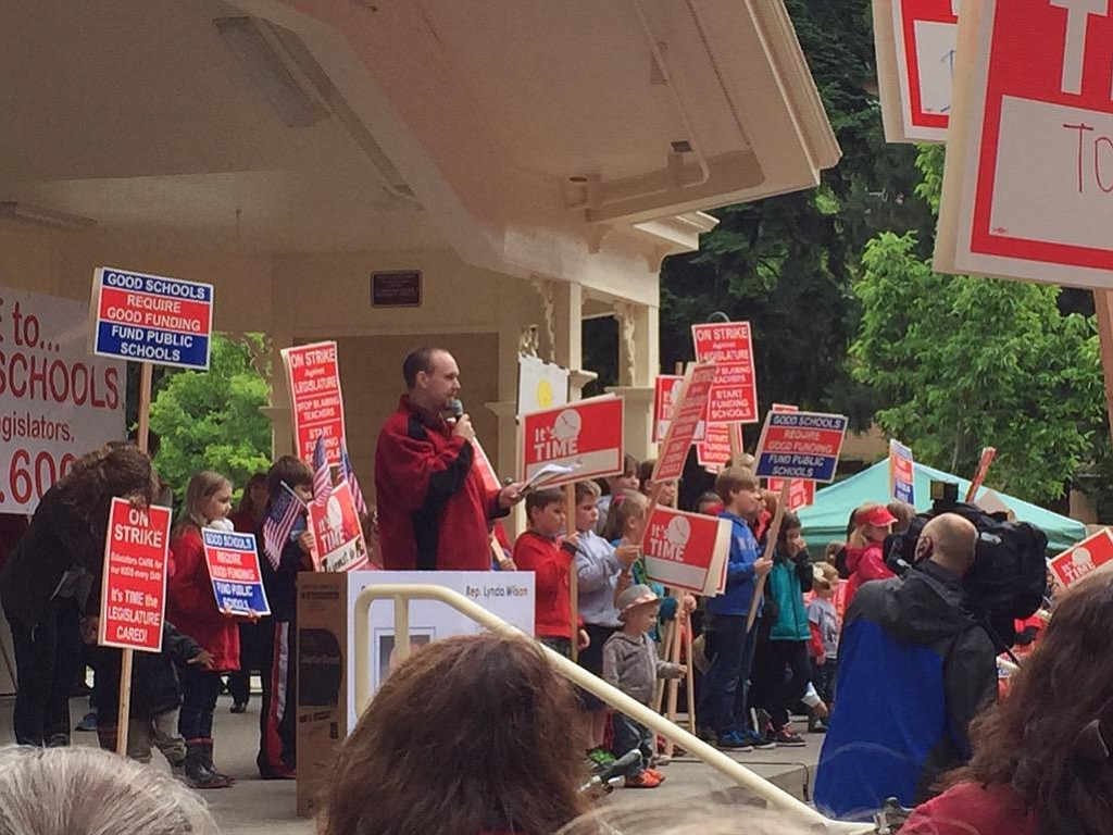 Rob Lutz, president of the Evergreen Education Association, speaks to teachers at the Esther Short Park rally this morning.