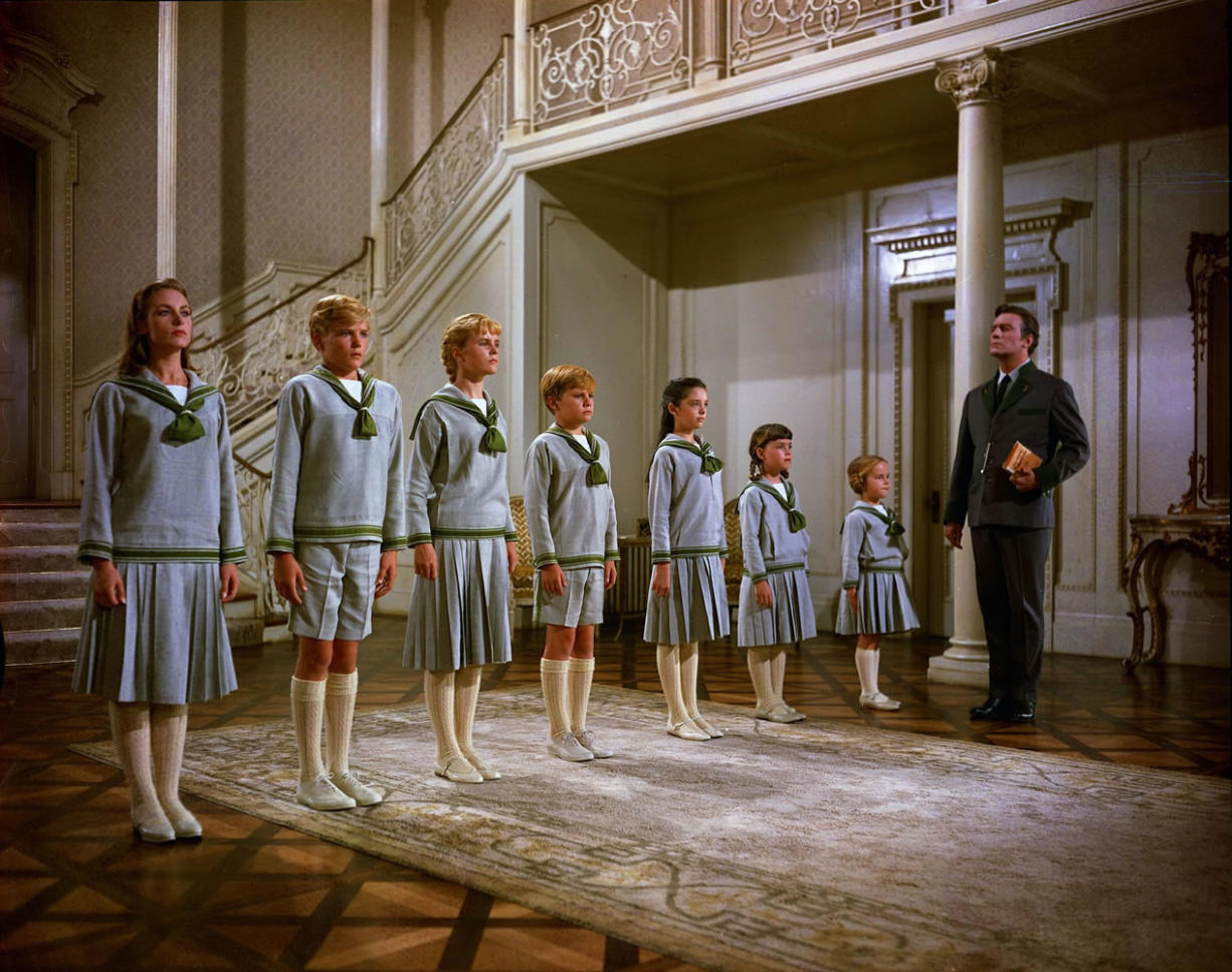 """Twentieth Century Fox Home Entertainment Charmian Carr as Liesl, from left, Nicholas Hammond as Friedrich, Heather Menzies as Louisa, Duane Chase as Kurt, Angela Cartwright as Brigitta, Debbie Turner as Marta, Kym Karath as Gretl, and Christopher Plummer as Captain von Trapp, in a scene from the film """"The Sound of Music."""" The 1965 Oscar-winning film adaptation of the Rodgers"""