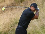 Tiger Woods reacts to his tee shot on the eighth hole during the first round of the U.S.