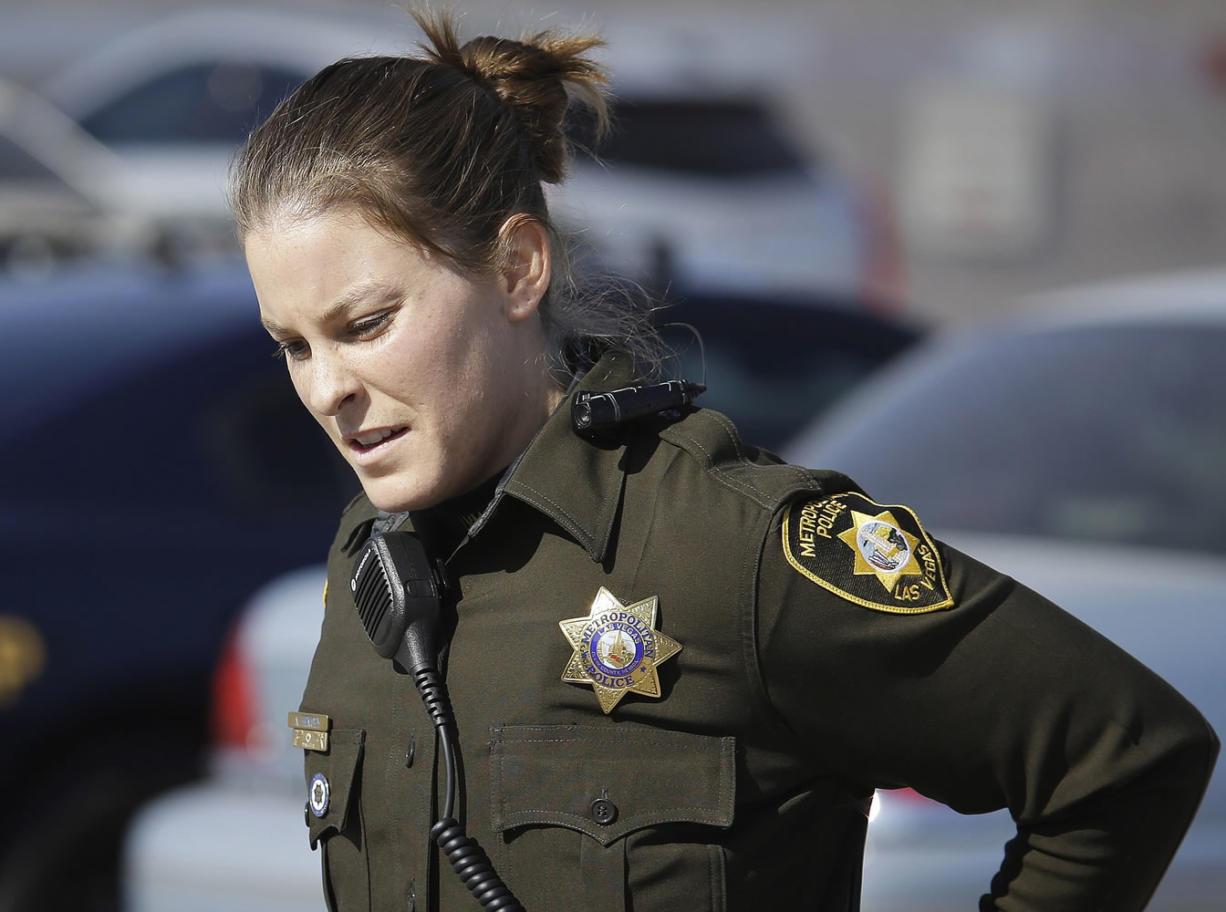 Las Vegas police officer Nicole Hemsey wears a body camera, seen on her shoulder,on Nov. 12 in Las Vegas.