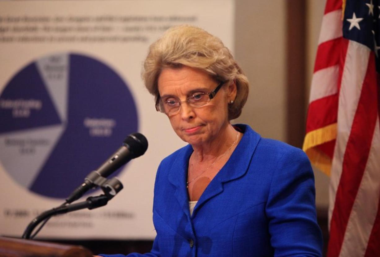 Gov. Chris Gregoire listens to a reporter's question after giving her presentation Thursday in Olympia.
