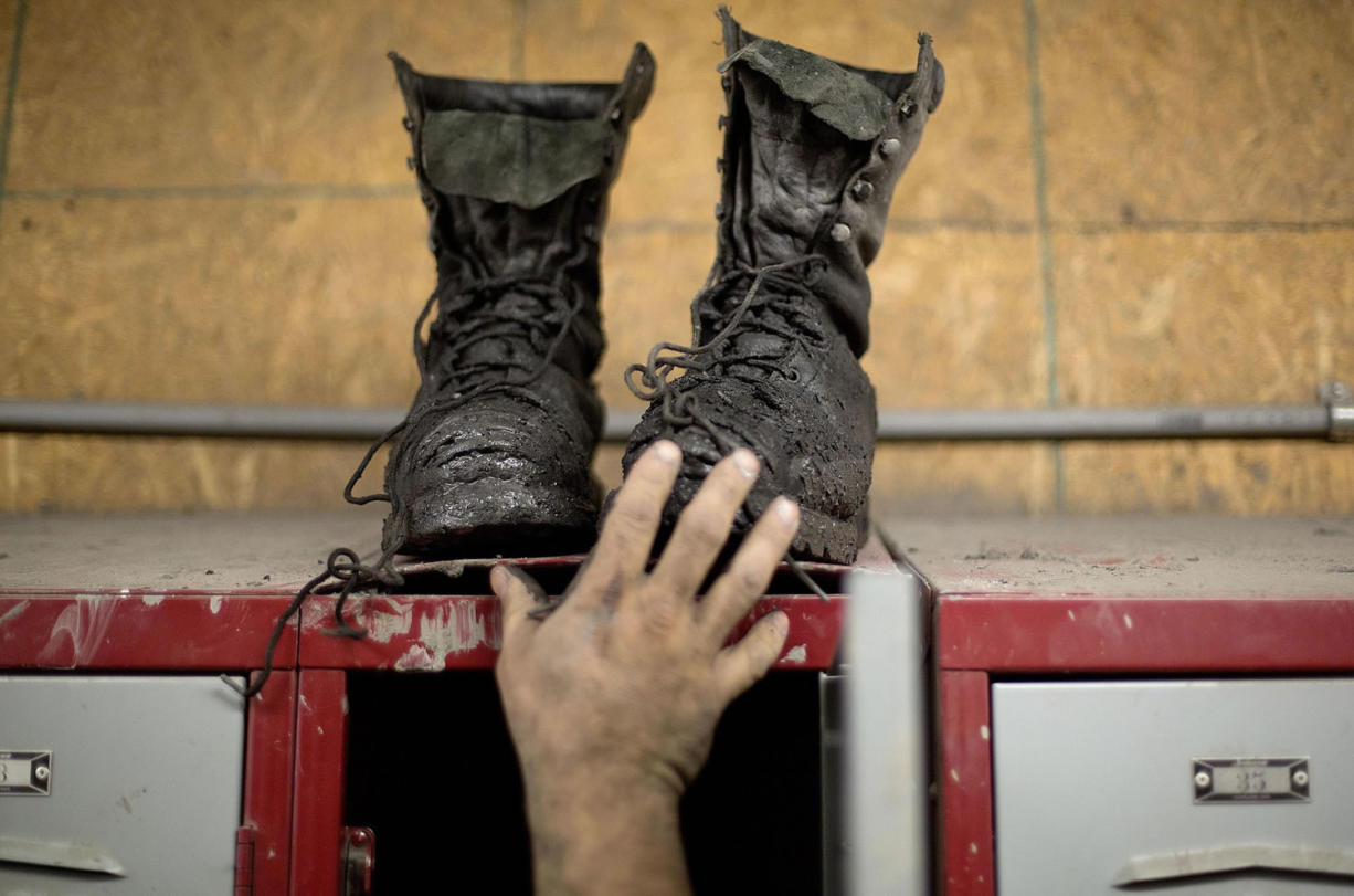 Coal miner Johnny Turner, 35, puts his coal boots on top of his locker after finishing a shift at the Perkins Branch coal mine in Cumberland, Ky., on Oct. 15.  Mine employment in Kentucky is at its lowest levels since the Great Depression.