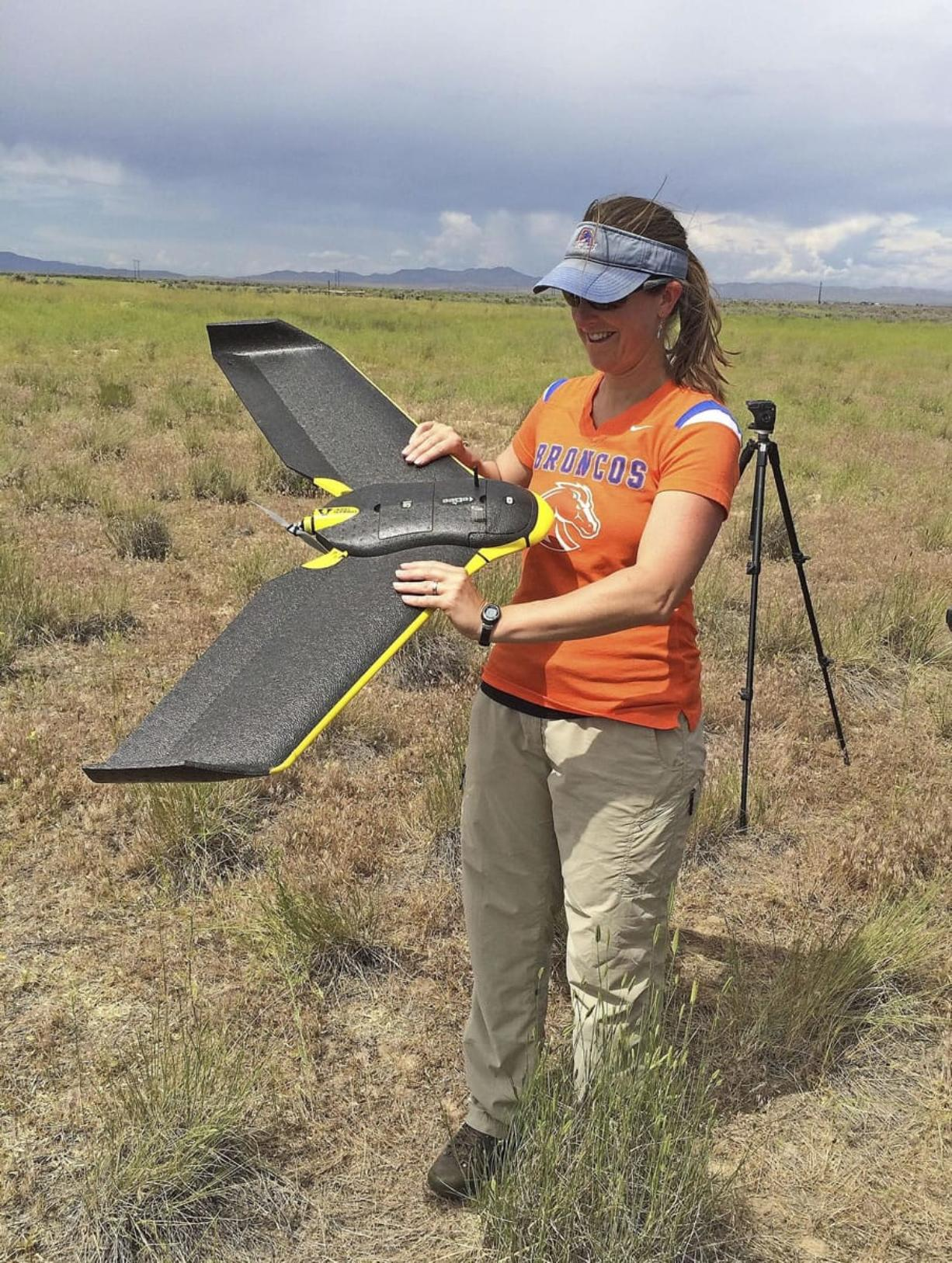 Boise State University Professor Jennifer Forbey examines a drone prior to launch June 10 in an area west of Boise, Idaho.