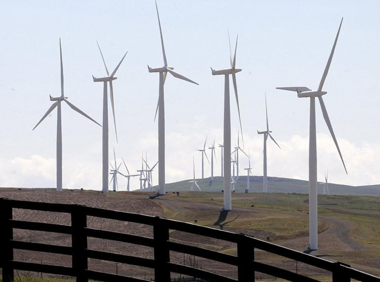 Clark Public Utilities has dodged a battle between wind and water power producers that's unfolding in the Northwest.