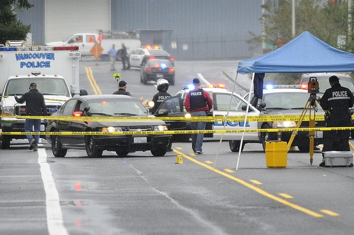 Vancouver police respond to the scene of a shooting in the Fruit Valley area Sept. 7. The shooting of an Iraq War veteran by three Vancouver officers was justified, Chief Criminal Deputy Prosecutor Denny Hunter said Wednesday.