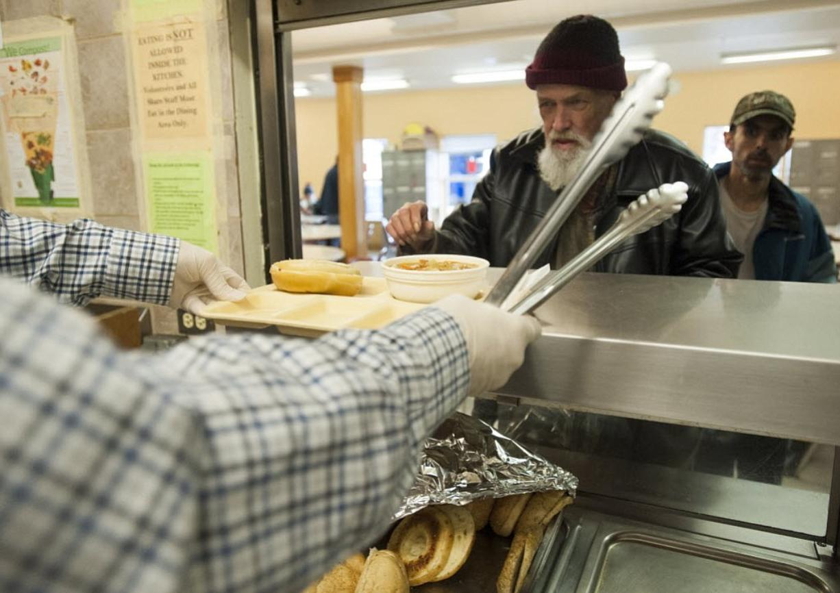 Lunch is served to the homeless at Share house in Vancouver on April 23. A single-day snapshot of homelessness in Clark County in January 2015 proves that more funding and better coordination of services makes a difference, according to Council for the Homeless Executive Director Andy Silver.