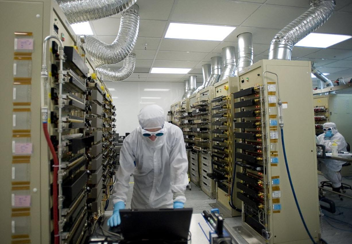 An nLight employee monitors temperature while running a test inside the Test Department in August 2011. Some Portland-Vancouver area employers say they have more manufacturing jobs than workers ready and willing to build their products.