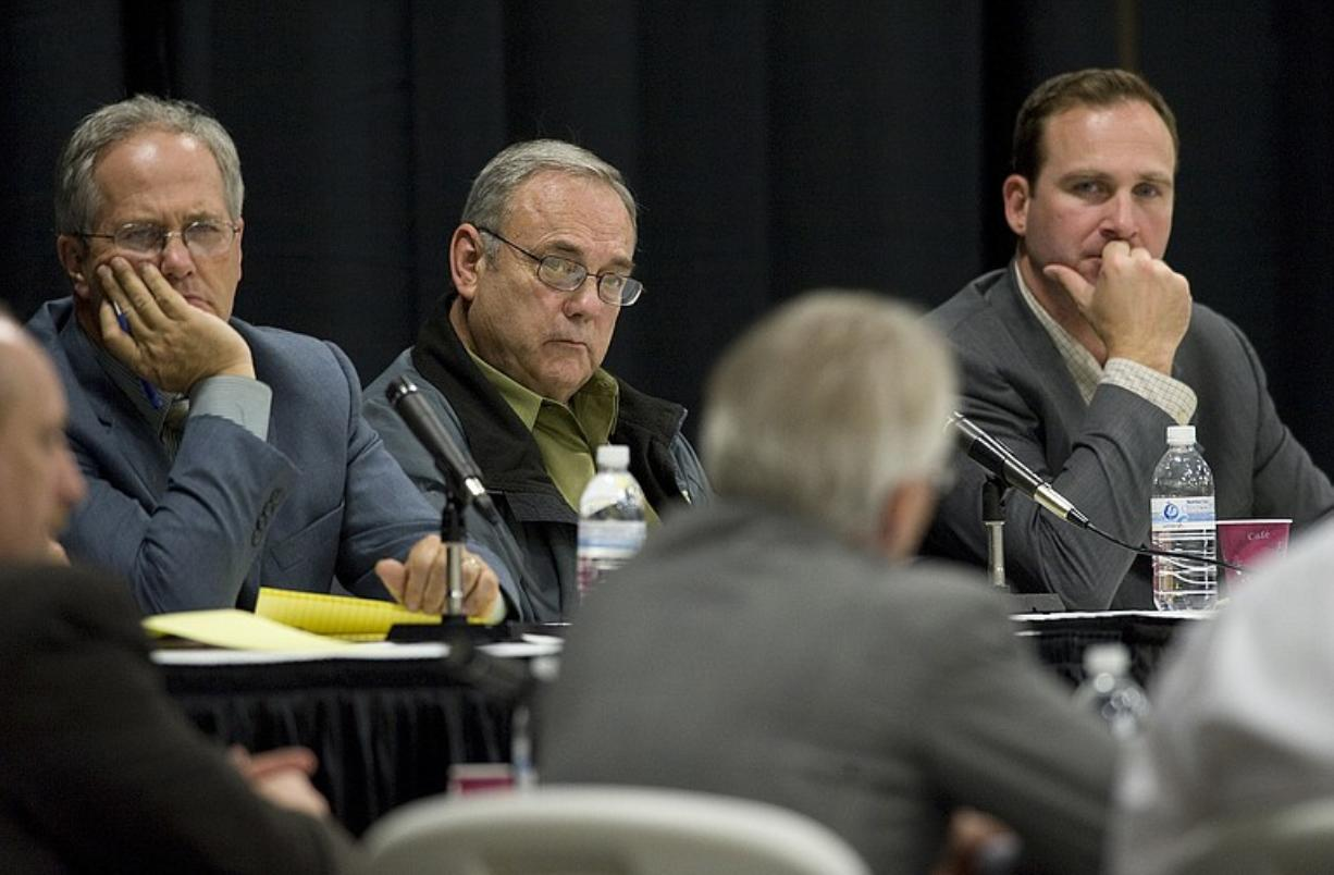 Clark County Commissioners, from left, Marc Boldt, Tom Mielke and Steve Stuart, listen to BPA Administrator Steve Wright during a meeting last year.