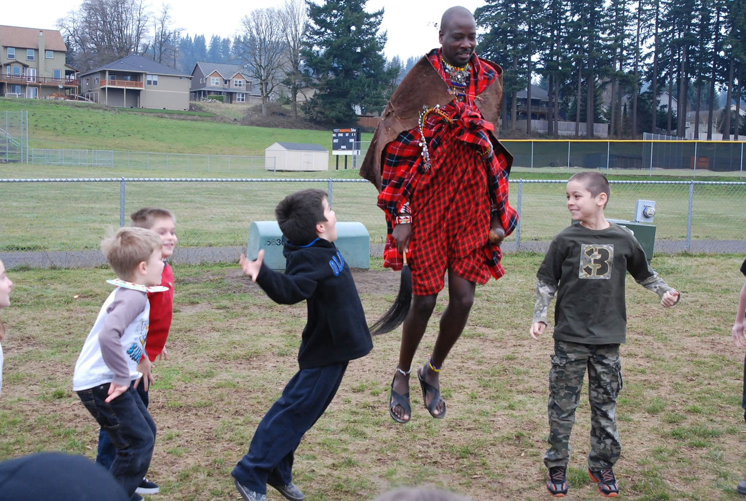 Washougal: Maasai Warrior and Elder Sabore Ole Oyie, from the Ewaso Nyiro region of Kenya, showed a tribal jumping dance to Gause Elementary second-graders during a special visit in February. Before his educational visit, kids learned a few Kiswahili words and even made mock passports.