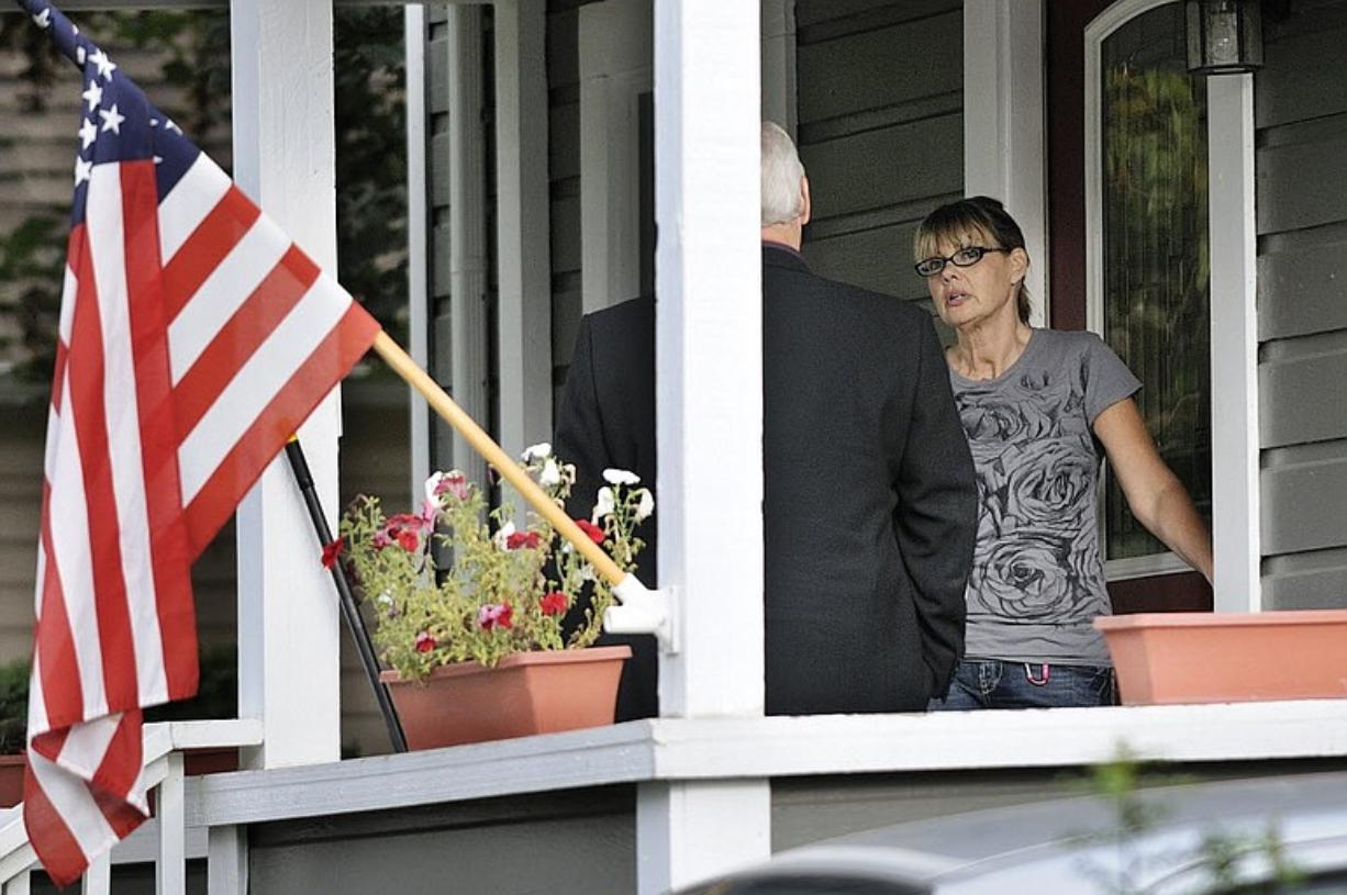 Nancy Neuwelt, the mother of Bethany Storro, talks to Vancouver Police Detective Wally Stefan at the Neuwelt home Monday evening in Vancouver, Washington. A warrant for Storro's arrest was issued earlier in the day.