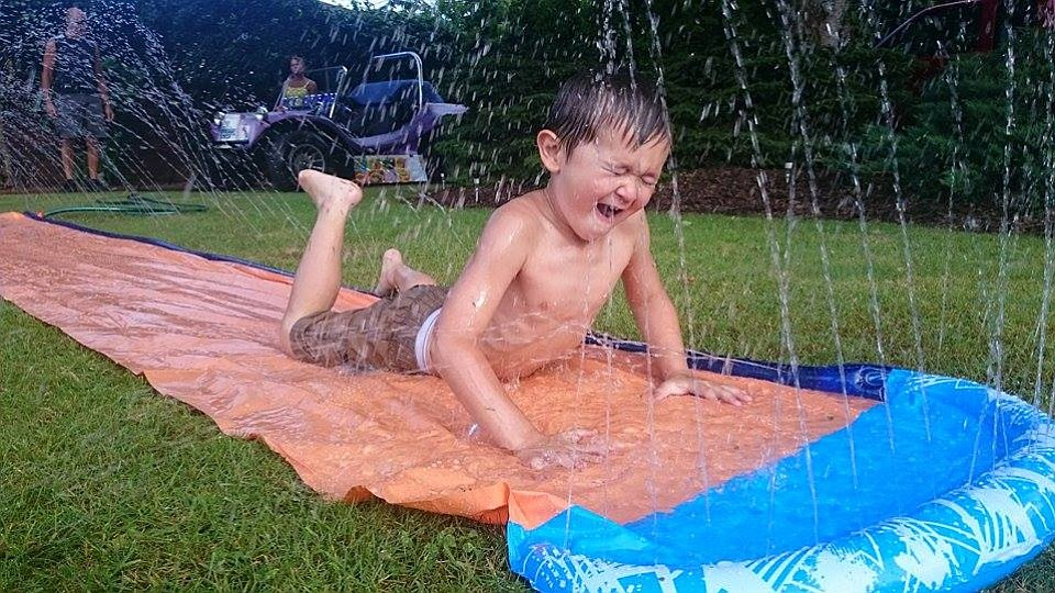 To replace previous picture.... This is the real Mason, my Great Grandson, having fun on a slip and slide.  Making a great memory at our family BBQ on a hot day in June 2015.