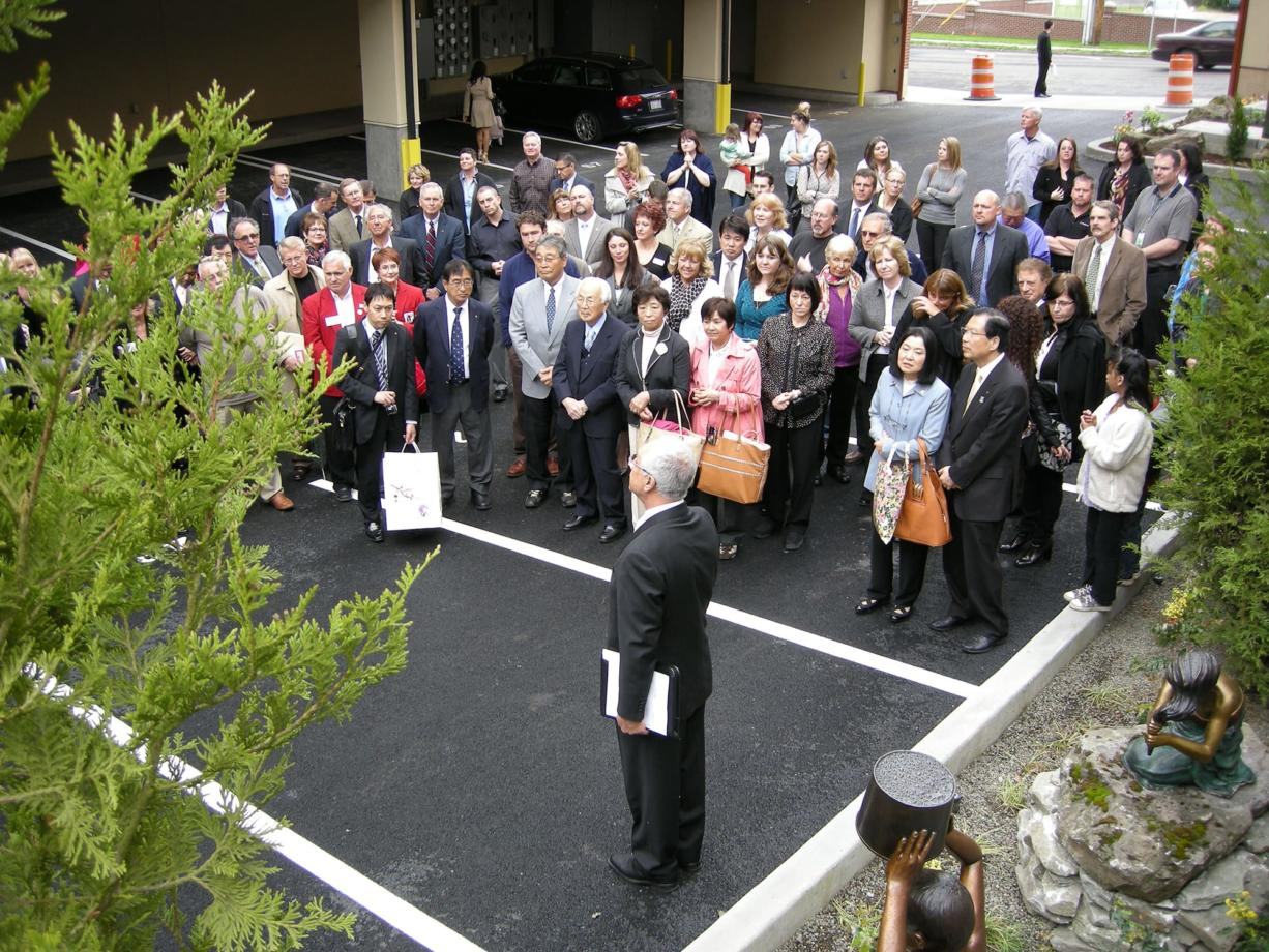 Elie, Kassab, president and owner of Prestige Development, addresses a crowd gathered Wednesday morning to celebrate the grand opening of Prestige Plaza, a $16 million apartment complex in downtown Vancouver.