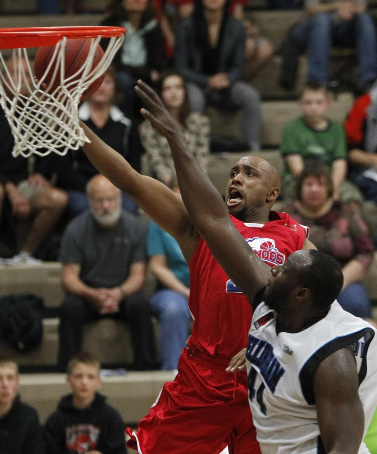 Vancouver Volcanoes guard Andre Murray, left, shoots against Bellingham in a game earlier this season.