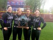Linfield College softball players Erin Tauscher (Camas), Erin Carson (Camas), Grace Middelstadt (Prairie) and McKenna Spieth (Union), from left, with the 2014 Northwest Conference tournament championship trophy.