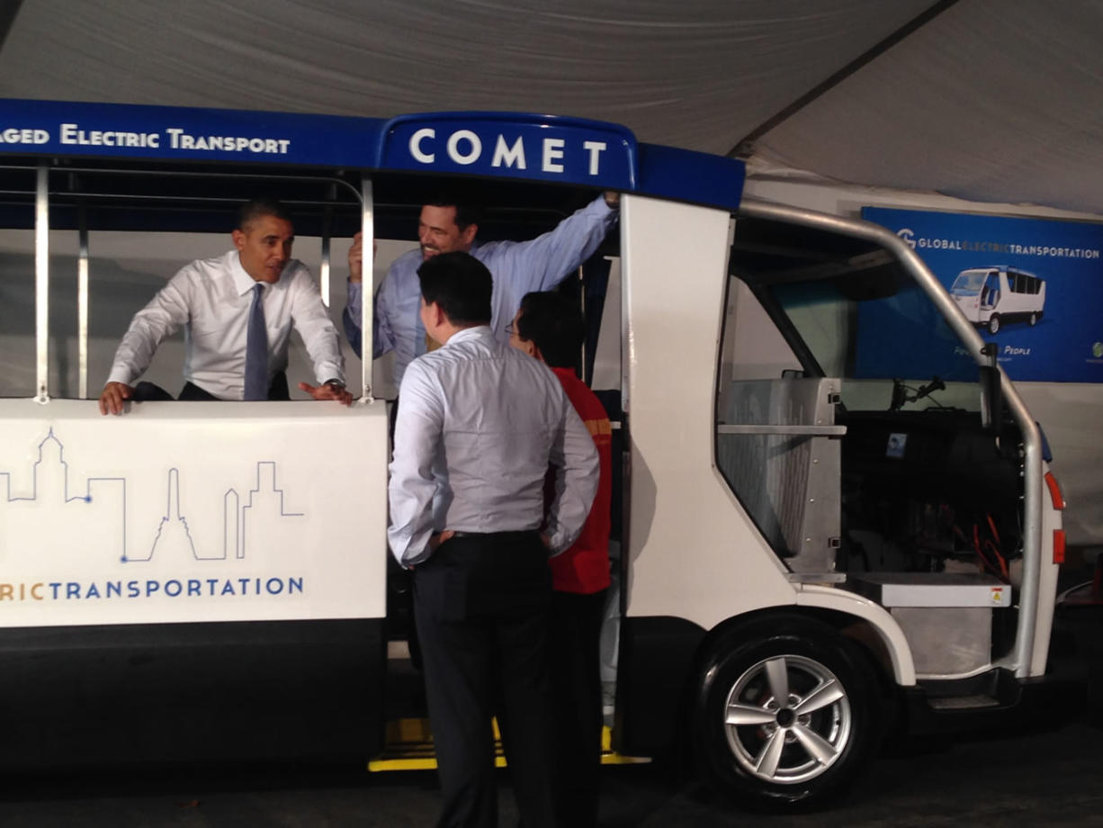 President Barack Obama looks over a Comet electric bus, designed and manufactured by Vancouver-based Pangea Motors, in Manila on Monday.