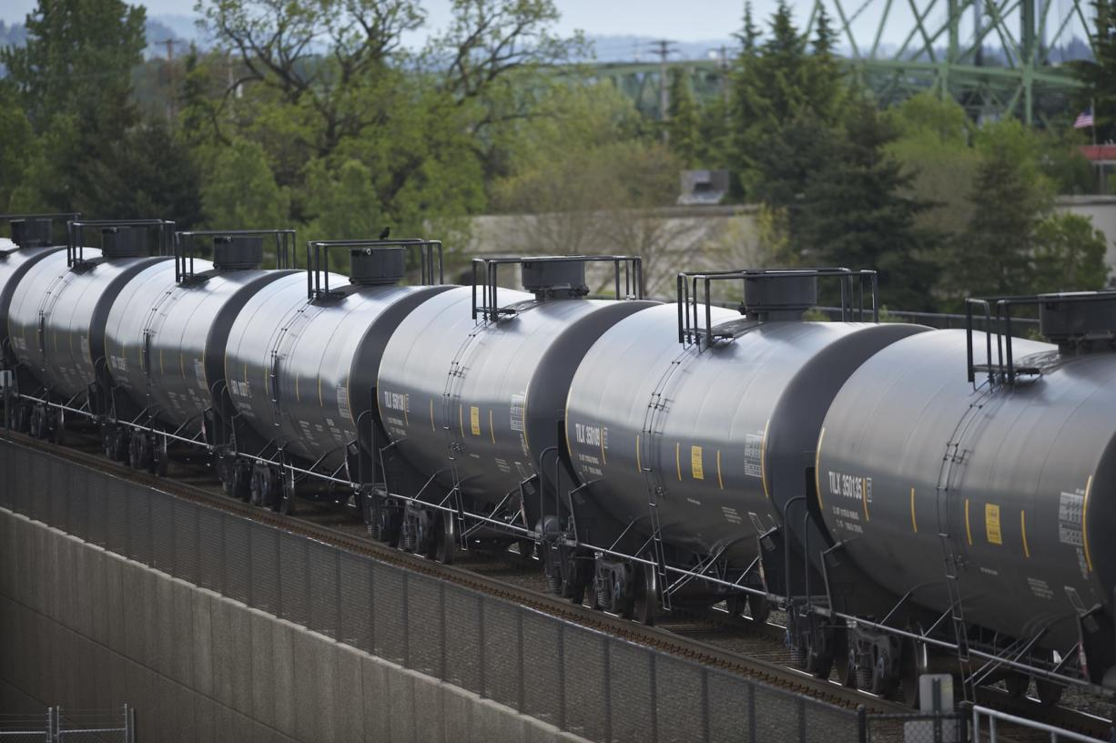 An oil train travels through downtown Vancouver in April. According to state estimates, crude oil shipments in Washington  went from zero in 2011 to 17 million barrels in 2013.