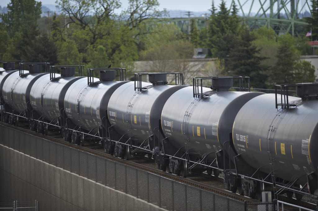 An oil train travels through downtown Vancouver in April.