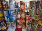People browse the aisles at a fireworks stand  at Northeast 63rd Street and Andresen Road on July 1, 2012.