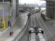 """The Port of Vancouver on Thursday morning, August 13, 2015, celebrated the completion of a new $30 million rail entrance project. Dubbed the """"trench,"""" it allows trains to move under the Columbia River Rail Bridge and to avoid conflicts with BNSF Railway and Union Pacific Railroad mainlines."""