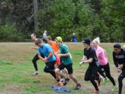 The Clark College cross country program is back at full strength after having just eight runners, including three men, last season. Here, runners from the men's and women's team run at Lewisville Park near Battle Ground.