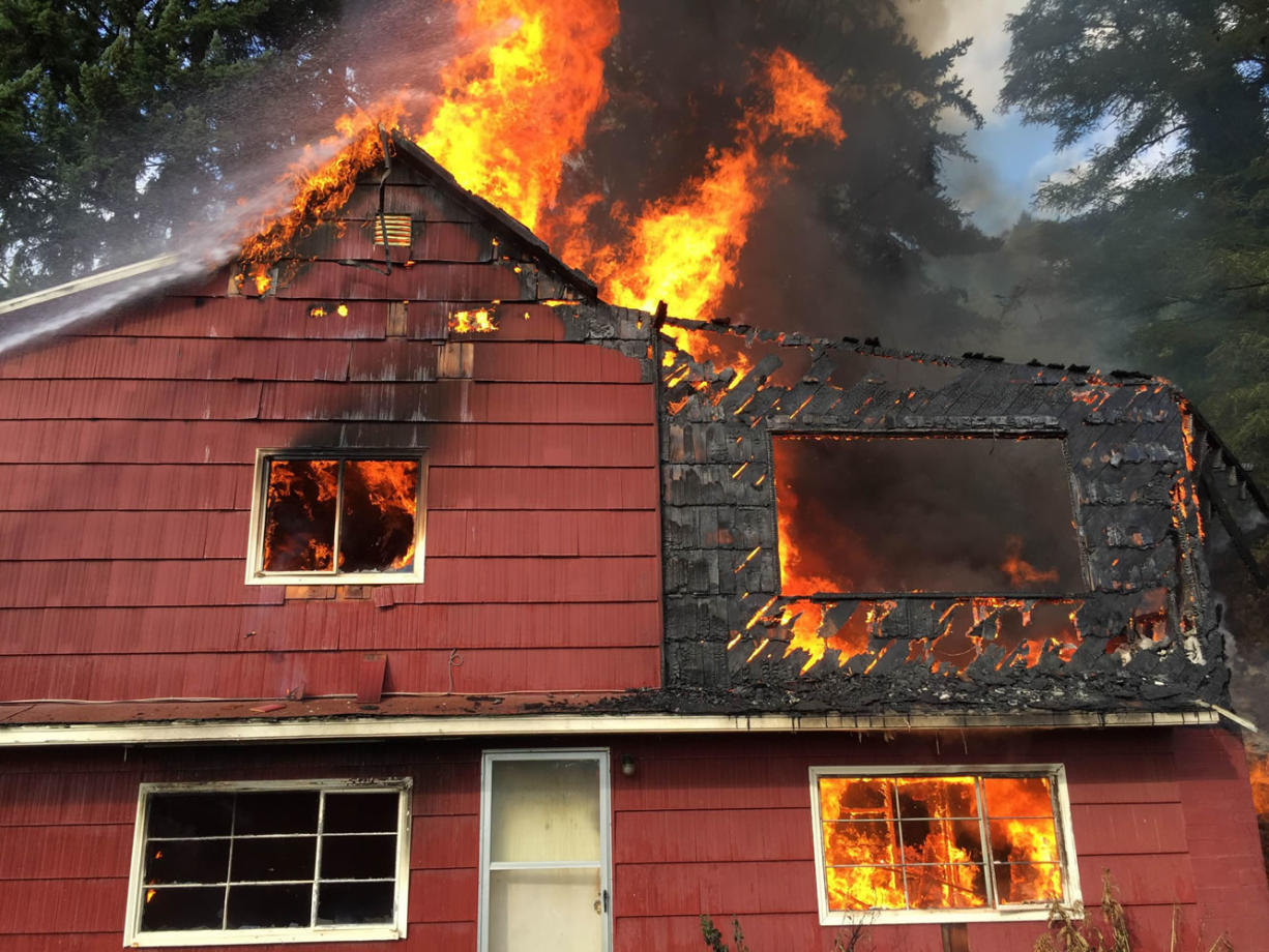 Flames engulf a home on Evergreen Highway in Camas.