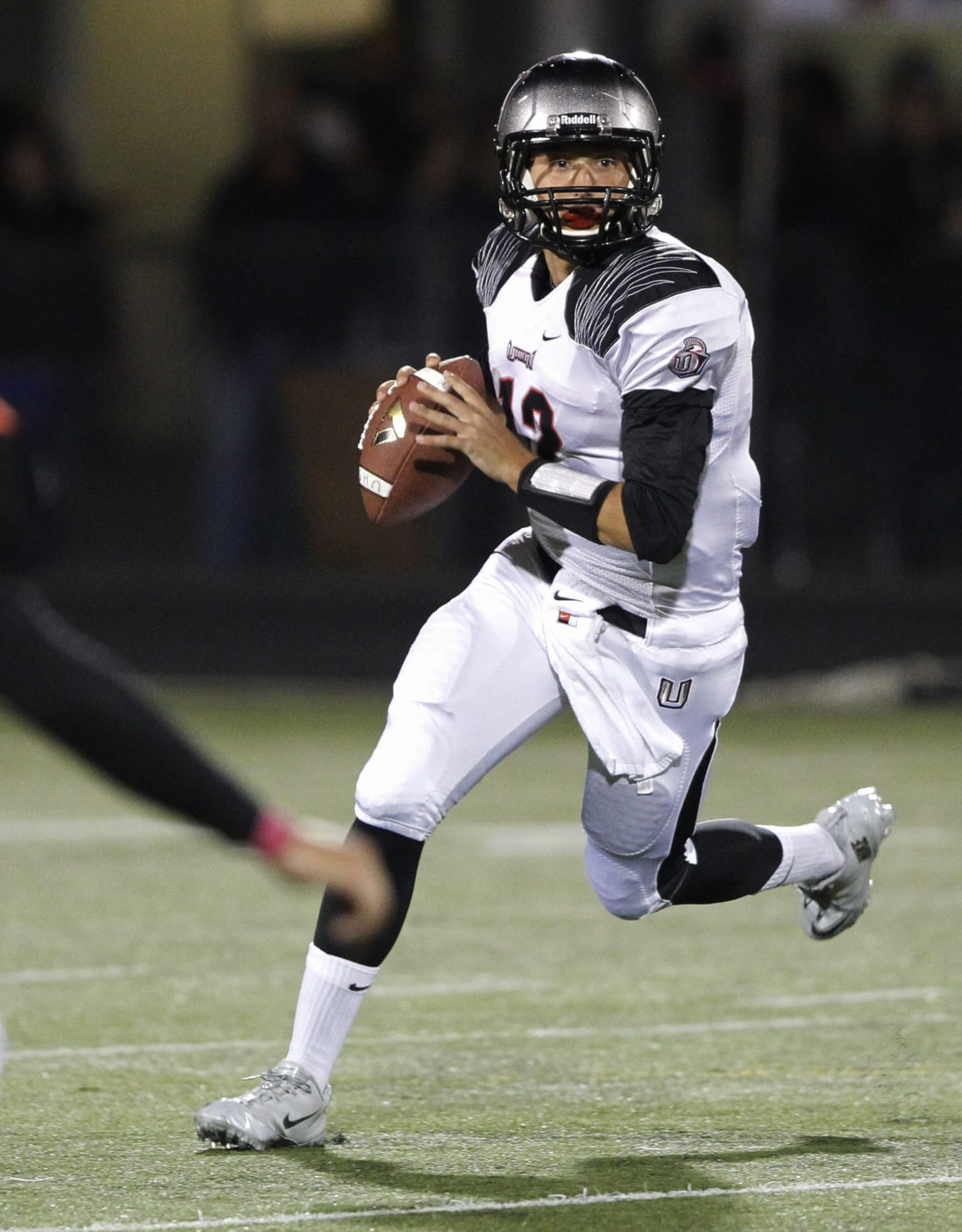 Union quarterback Nolan Henry rolls out against Battle Ground. (Steve Dipaola for the Columbian)