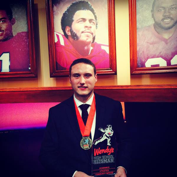 Union High School senior Nolan Henry with the 2014 Wendy's High School Heisman award, presented to him on Friday, Dec. 12, 2014 in New York. Henry posted this image on Twitter, shortly after winning the award.