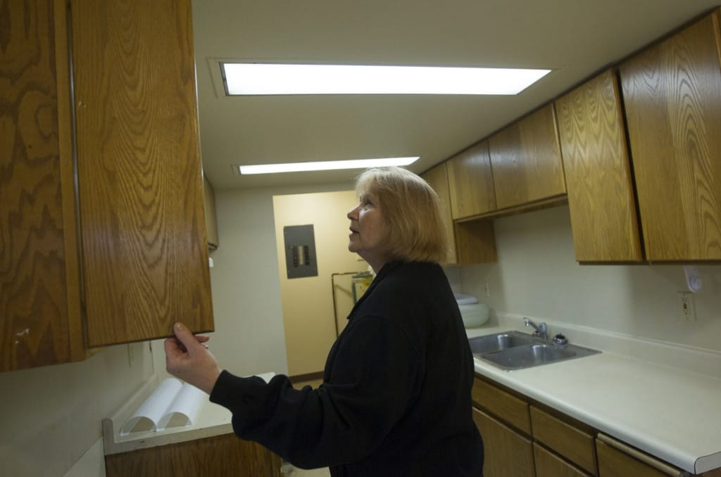 Vancouver City Councilwoman Anne McEnerny Ogle Checks Out The Kitchen  Cabinets At Skyline Crest.