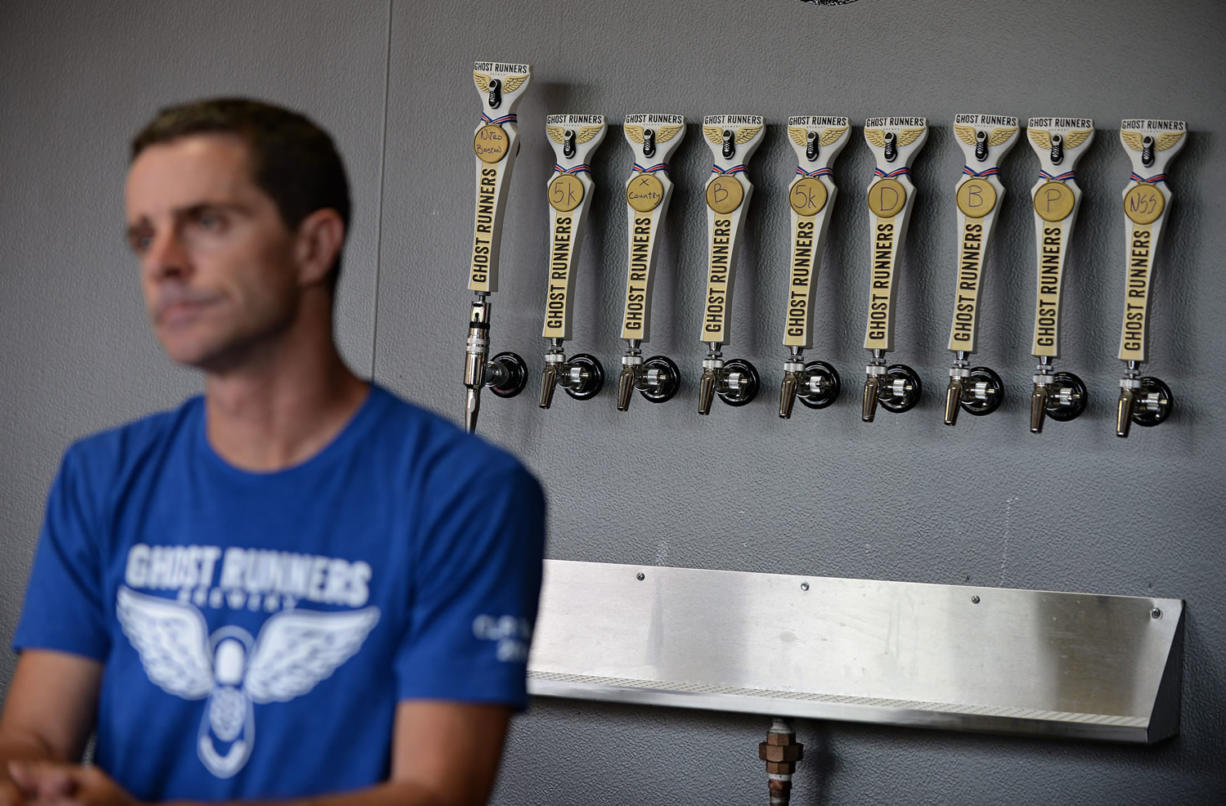 Co-owner Rob Ziebell offers a range of beers, all with running-related names, at Ghost Runners Brewery. The most popular picks are the 5K IPA and the Boston Irish Red Ale.