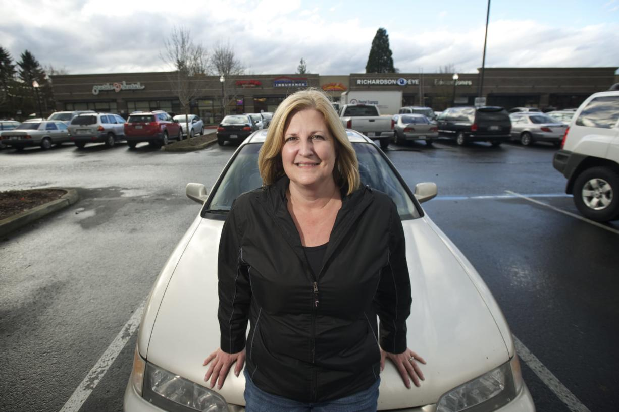 Rhonda Ouchida of Battle Ground stands in front of her 1995 Honda Accord.