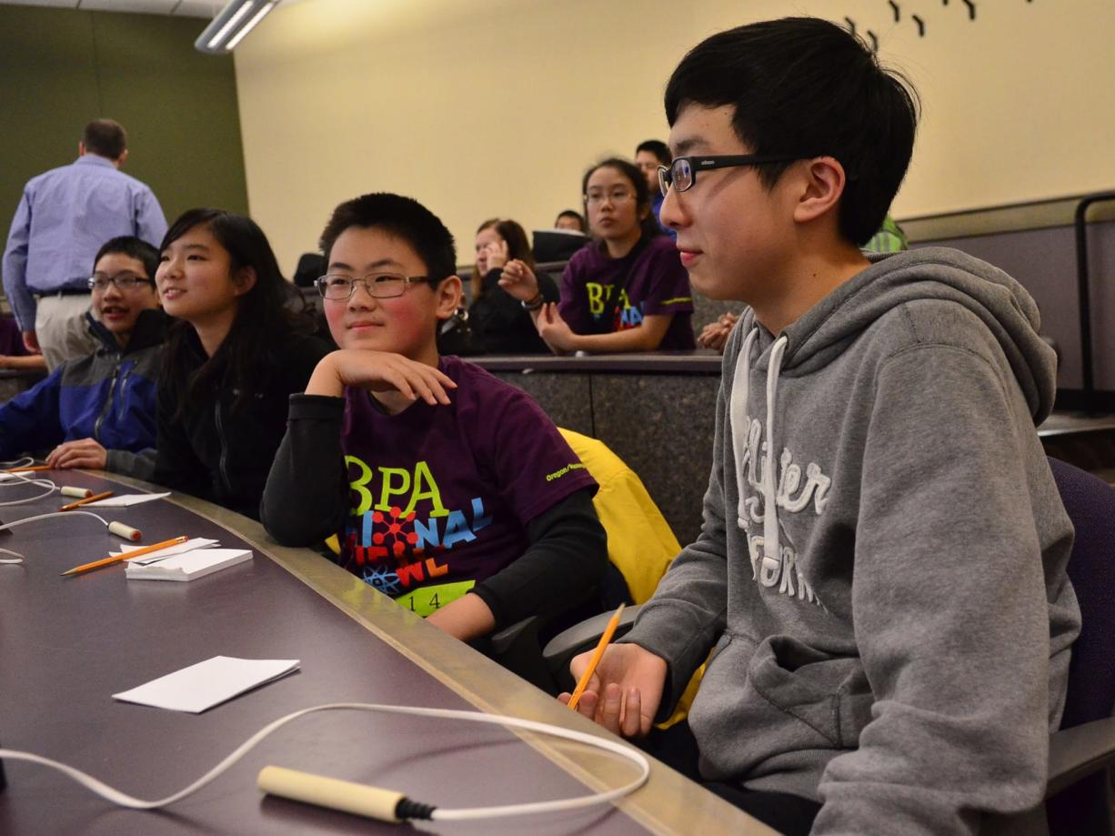 From left, Edmond Hsu, Sabrina Wang, Phillip Meng and Enoch Tsai of Shahala Middle School in Vancouver get ready for a round Saturday during the middle school competition for the BPA Regional Science Bowl at the University of Portland.