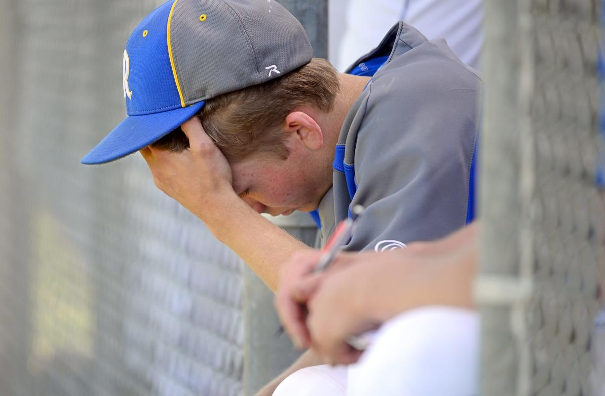 In this photo taken Tuesday, May 13, 2014, Rochester High School pitcher Dylan Fosnacht rests between the 13th and 14th inning of a District IV 1A baseball tournament first-round game against La Center, at Rochester High School in Rochester, Wash. Fosnacht threw 194 pitches as he took a shutout into the 15th inning. His team beat La Center 1-0 in 17 innings.