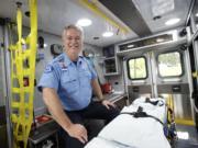 American Medical Response paramedic Rick Futrell sits inside an ambulance.