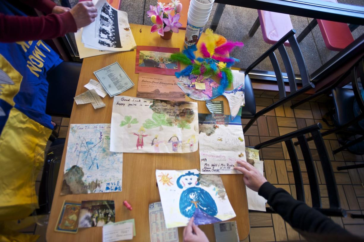 Items unearthed from a time capsule that Salmon Creek Elementary School students and staff buried in 1994 are displayed Sunday at the McDonald's in Salmon Creek. Among the contents were a Troll doll, two Jolly Ranchers, student artwork and a school lunch menu.