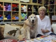 Jennifer Powell, with her dog, Bentley, at her store Wooly Wooly Wag Tails Yarn in Washougal.
