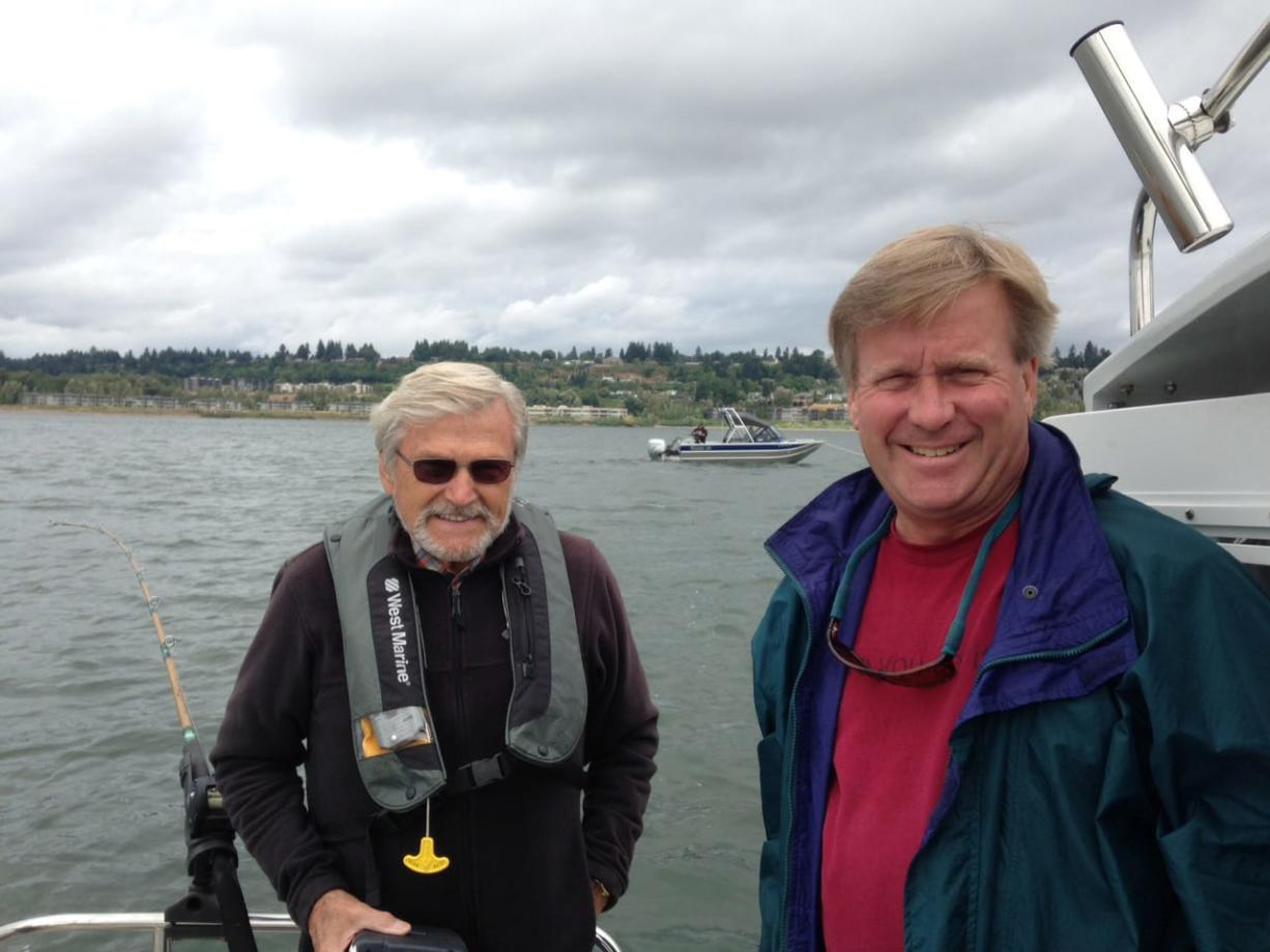 Charles Kellogg, left, fishes for salmon with longtime friend Jeff Sleight on the Columbia River on Aug. 30.