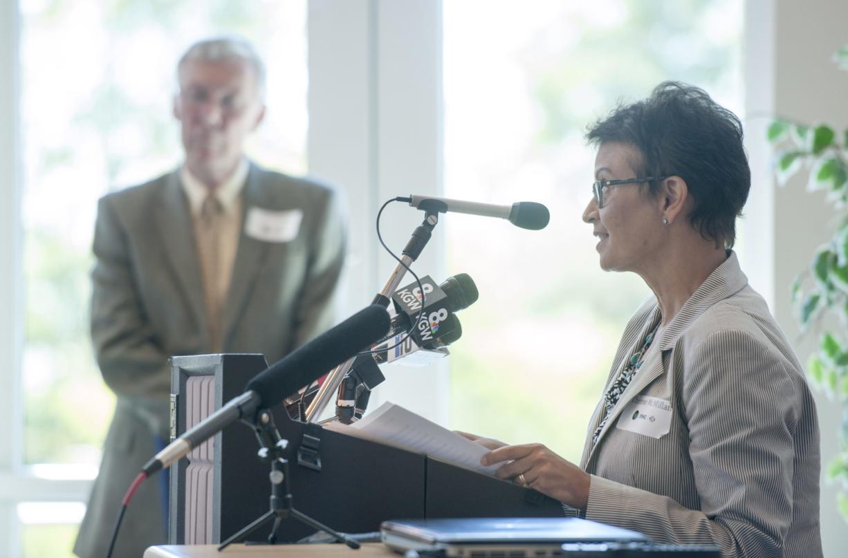FTA Administrator Therese McMillan speaks as C-Tran CEO Jeff Hamm listens in the background, at an event at Clark College in Vancouver, Thursday September 10, 2015. McMillan officially announced a $38.5 million grant award for C-Tran's bus rapid transit project known as The Vine.