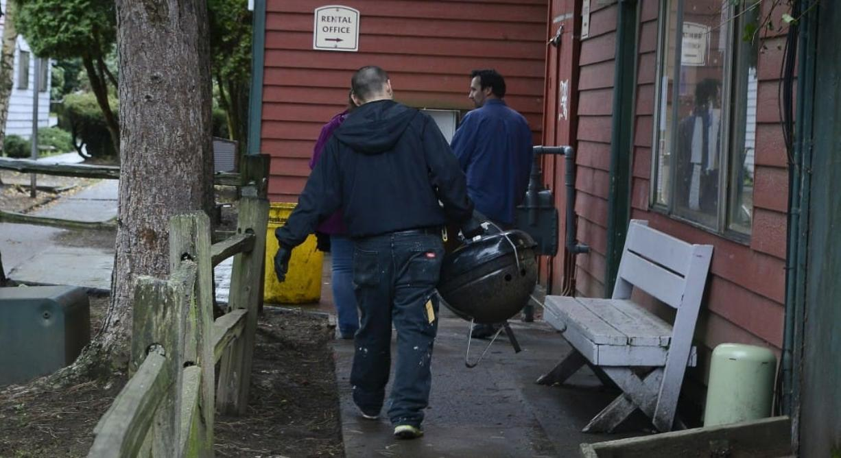 Courtyard Village Apartments residents on Dec. 10 started cleaning up the grounds and removing everything that had been left outside, including personal possessions such as a barbecue grill, after residents were given notice to vacate. The Vancouver City Council unanimously approved three ordinances Monday night designed to protect vulnerable, low-income renters. The ordinances will give renters more time to find new housing when told to vacate or told that rent is increasing, and would prevent landlords from refusing to rent to people based on their source of income.